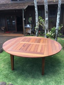 Solid teak table with removable leaf inserts